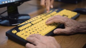Keyboard with large yellow keys and large print letters and numbers